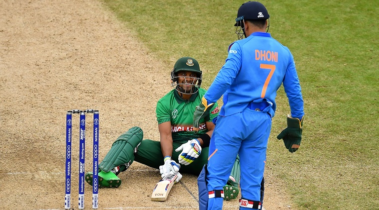 BIRMINGHAM, ENGLAND - JULY 02: Sabbir Rahman of Bangladesh slips as he bats and smiles at MS Dhoni of India during the Group Stage match of the ICC Cricket World Cup 2019 between Bangladesh and India at Edgbaston on July 02, 2019 in Birmingham, England. (Photo by Clive Mason/Getty Images)